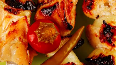 bbq grill : fresh grilled  shish kebab on green platter with vegetables Stock Footage