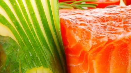 freshness background : fresh smoked salmon fillet with vegetables and rosemary Stock Footage