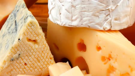 emmental : many delicious aged cheeses on wooden plate Stock Footage
