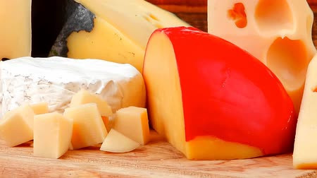 cheese piece : many delicious aged cheeses on wooden plate Stock Footage