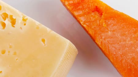 soft cheeses : aged parmesan roquefort and gruyere chops delicatessen cheeses plate 1920x1080 intro motion slow hidef hd Stock Footage