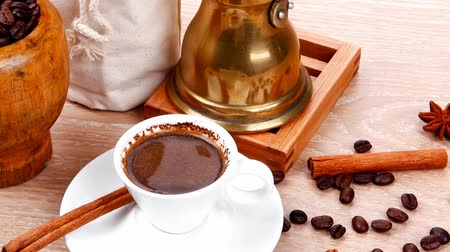 biała czekolada : sweet hot drink : black turkish coffee in small white mug with mortar and pestle   coffee beans in white bag   copper old style cezve full hot coffee  decorated with cinnamon sticks and anise stars 1920x1080 intro motion slow hidef hd