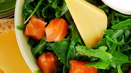 fresh cheeses : green salad with salmon and tomatoes in green bowl 1920x1080 intro motion slow hidef hd