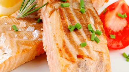 antre : healthy fish cuisine : grilled pink salmon steaks dish over wooden table 1920x1080 intro motion slow hidef hd
