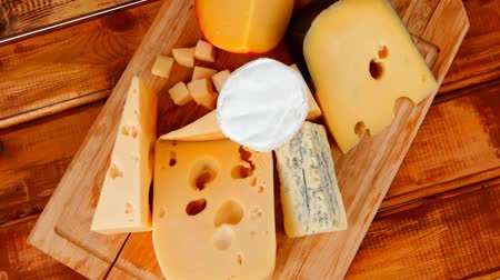 soft cheeses : different cheeses served on wooding cutting board 1920x1080 intro motion slow hidef hd