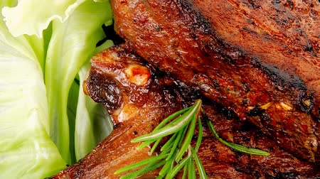 capers : meat savory: roast ribs on black plate with peppers and chives 1920x1080 intro motion slow hidef hd