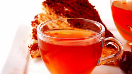 alimentos doces : black english tea and cakes with red cherry 1920x1080 intro motion slow hidef hd