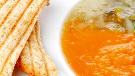 zupa : european cuisine: dual components vegetable soup served with toasts on wood 1920x1080 intro motion slow hidef hd