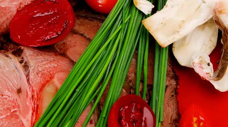 beef dishes : roasted meat served on red dish with vegetables 1920x1080 intro motion slow hidef hd Stock Footage