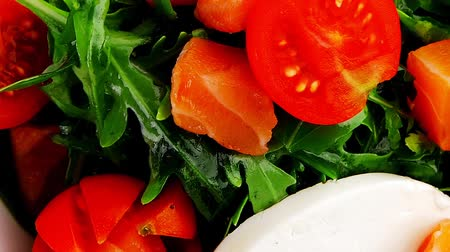 fresh cheeses : fresh green salad with smoked salmon in white bowl 1920x1080 intro motion slow hidef hd