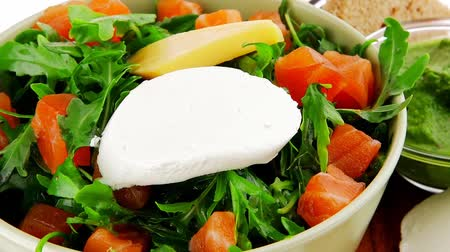 fresh cheeses : green salad with smoked salmon in green bowl on plate 1920x1080 intro motion slow hidef hd