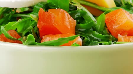 fresh cheeses : green salad with smoked salmon in green bowl on plate