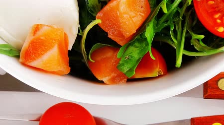 fresh cheeses : green salad with salmon and tomatoes in white bowl 1920x1080 intro motion slow hidef hd Stock Footage