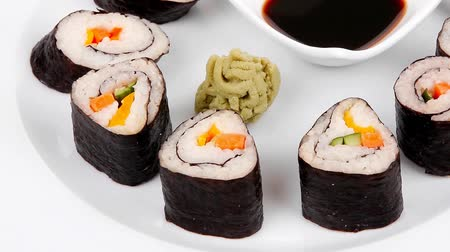 comida japonesa : Japanese traditional Cuisine - Roll with Cucumber   Cream Cheese with raw Tuna(maguro) and Salmon(sake) inside. dish with sticks 1920x1080 intro motion slow hidef hd