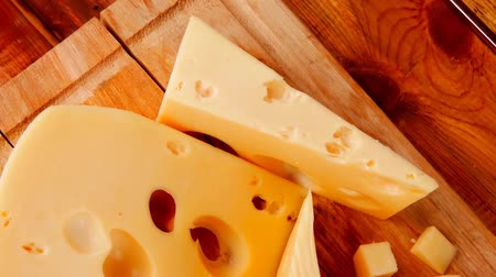 emmental : different type of cheese served on wood 1920x1080 intro motion slow hidef hd Stock Footage