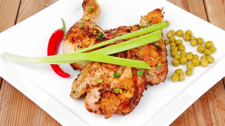 antre : meat food : chicken legs garnished with green peas and hot chili peppers plates over wooden table 1920x1080 intro motion slow hidef hd