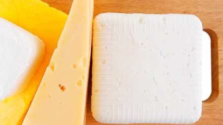 soft cheeses : goat cheeses and yellow on wooden board 1920x1080 intro motion slow hidef hd
