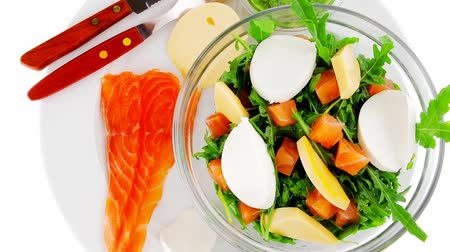 italian food : healthy diet food - fresh green lettuce salad with smoked salmon an light white goat feta cheese in transparent bowl 1920x1080 intro motion slow hidef hd Stock Footage