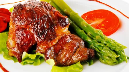 beef dishes : roasted beef meat served with asparagus on plate 1920x1080 intro motion slow hidef hd