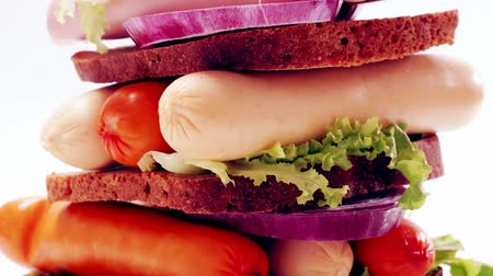 ebéd : fresh beef meat sausage sandwich with green salad and tomatoes 1920x1080 intro motion slow hidef hd Stock mozgókép