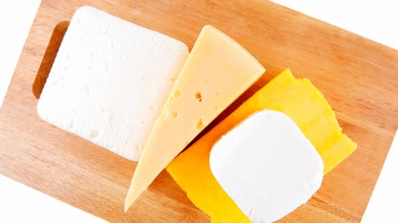 soft cheeses : delicious cheeses served on wooden board 1920x1080 intro motion slow hidef hd