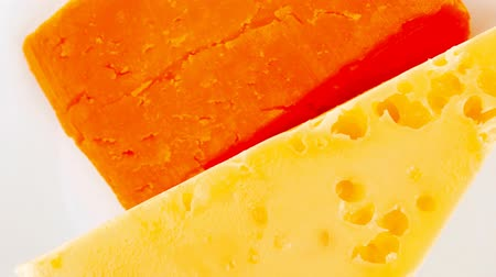 гауда : cheese : french gourmet triangles of yellow parmesan and orange cheddar on a plate 1920x1080 intro motion slow hidef hd