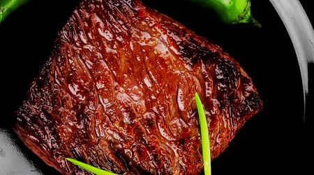 cielęcina : meat food : roast beef fillet mignon served on black plate with chili pepper 1920x1080 intro motion slow hidef hd