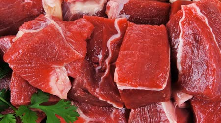 cielęcina : fresh uncooked beef meat slices over wooden cutting board ready to prepare with green hot and red peppers 1920x1080 intro motion slow hidef hd