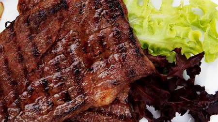 asal : meat food : two grilled steak with chili and red peppers   green lettuce salad   on dish 1920x1080 intro motion slow hidef hd