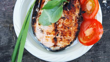 grillowanie : grilling salmon steak with milk cream in grid over barbecue 1920x1080 intro motion slow hidef hd