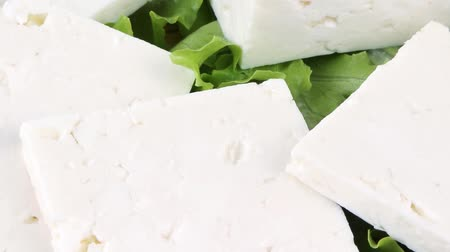 pieces of cheese : white goat cheese served on wooden plate 1920x1080 intro motion slow hidef hd Stock Footage