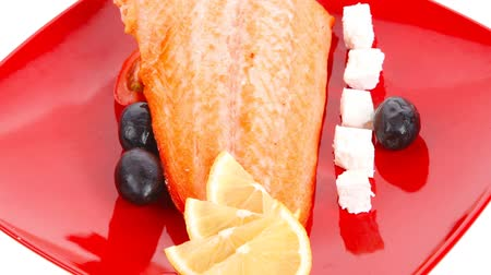 carne : roast salmon fish meat fillet with lemon black greek olives white goat cheese on red plate 1920x1080 intro motion slow hidef hd