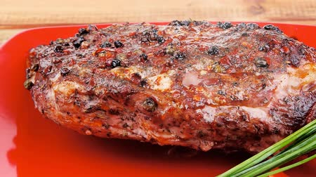 peppercorn : meat : grlled meat shoulder on red plate with tomatoes green lettuce over wooden table 1920x1080 intro motion slow hidef hd Stock Footage