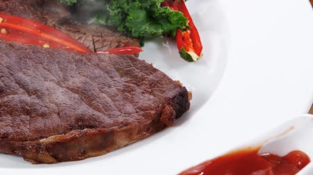 filet : grilled beef steak fillet meat with red hot pepper and raw kale leaf with ketchup sauce served plate over wood table 1920x1080 intro motion slow hidef hd Stock Footage