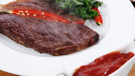 jarmuż : grilled beef steak fillet meat with red hot pepper and raw kale leaf with ketchup sauce served plate over wood table 1920x1080 intro motion slow hidef hd Wideo