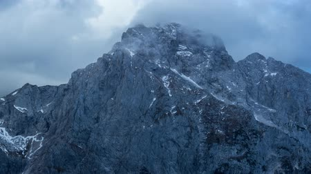 alpinism : Timelapse of clouds going through the mountain in Julian alps Stock Footage