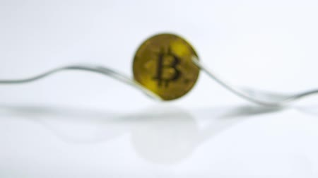 wallet : Slide zoom in focus shot of Bitcoin fork concept on the white background with reflection