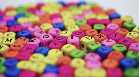 kaligrafia : Letters on the table, spinning colored letters on a white table. The concept of studying the alphabet. Wideo
