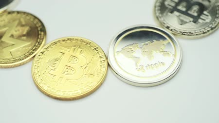 Cryptocurrency spinning in a circle close-up on a white background. The concept of the banking system.