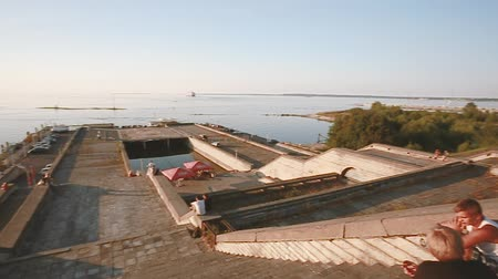 heliport : Tallinn, Estonia. People Resting In Linnahall In sunset sunrise time in summer season. Linnahall is a former concert or sports venue. It is situated on harbour, just beyond walls of Old Town and was completed in 1980 Stock Footage