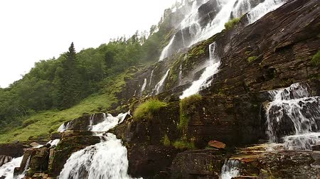 tvindefossen : Waterfall Valley, Norway. Waterfall Tvindefossen Is Largest And Highest Waterfall Of Norway, Its Height Is 152 M. Famous Landmark