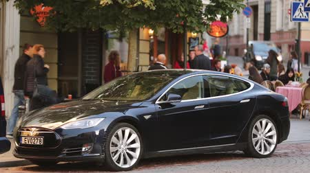 tesla model s : Tesla Model S Car In Motion On Street. The Tesla Model S Is A Full-sized All-electric Five-door, Luxury Liftback, Produced By Tesla Inc. Stock Footage