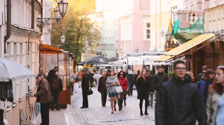 Литва : Vilnius, Lithuania. People Walking On Pilies Street Of Old Town In Autumn Day