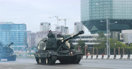 soldiers : Minsk, Belarus. Military Self-propelled Guns And Howitzers Moving Near National Library During Rehearsal Before Celebration Of The National Holiday Independence Day Of Belarus