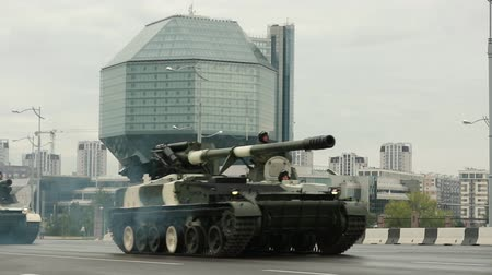 propelled : Minsk, Belarus. Military Self-propelled Guns And Howitzers Moving Near National Library During Rehearsal Before Celebration Of The National Holiday Independence Day Of Belarus