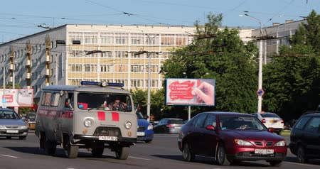 reanimation : Vitebsk, Belarus. Soviet Emergency Ambulance Van UAZ Car Moving On Street In Summer Day. Traffic At Street. Pan, Panorama