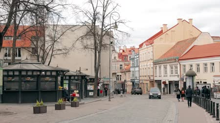 vilnius old town : Vilnius, Lithuania. People Walking On The Pedestrian Paved Pilies Street In Spring Day. Stock Footage