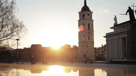 vilnius old town : Vilnius, Lithuania. People Walking In Cathedral Square Near Cathedral Basilica Of St. Stanislaus And St. Vladislav With The Bell Tower In Spring Sunset