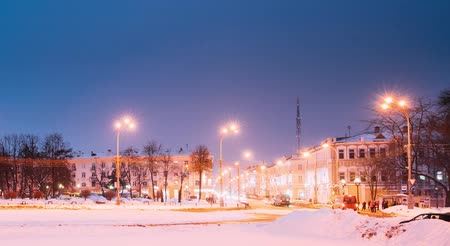 lenin : Gomel, Belarus. Time Lapse Time-lapse From Day To Night. Traffic And Light Trails Near Building Of Gomel Regional Drama Theatre On The Lenin Square In Winter Season. Change Of Day To Night