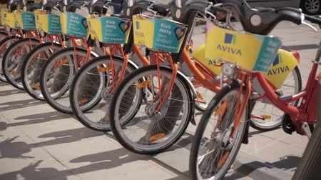 vilnius old town : Vilnius, Lithuania. Row Of Colorful Bicycles AVIVA For Rent At Municipal Bike Parking In Street. Stock Footage